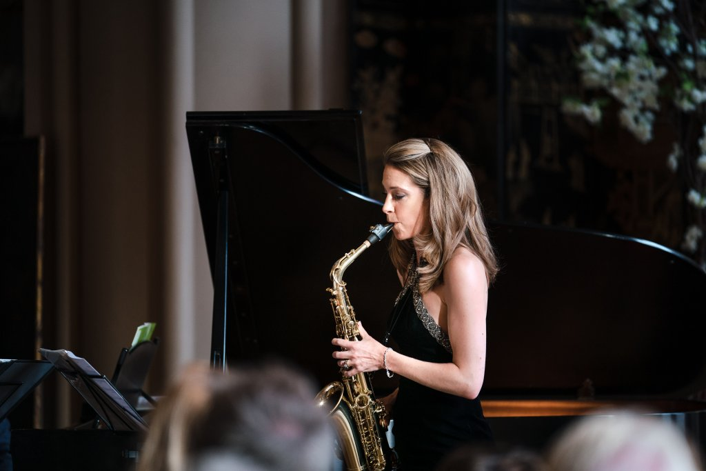 Amy Dickson playing her saxophone at Belvoir Castle